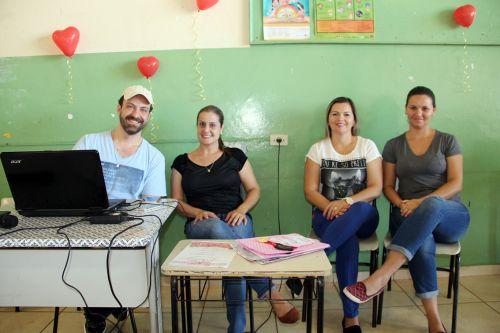 Professores colaborando com o evento
