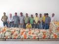 Parte dos agricultores beneficiados com a distribuição de sacas de milho